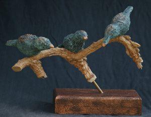 3 vogeltjes op stok, brons blok.
